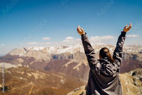 Hiker celebrating,taking mask off in nature Canvas Print
