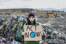 Woman Activist With Placard Poster On Landfill, Environmental Pollution Concept.
