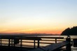 Scenic View Of River Seen Through Bridge Against Sky During Sunset