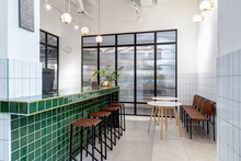 Modern Kitchen With Large Green Bar