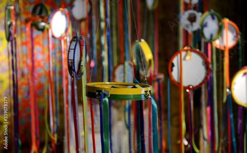 Obraz na płótnie Tambourines Hanging With Multi Colored Ribbons