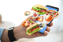 Man Using Smartphone For Ordering Food Online, Closeup. Delivery Service During Quarantine
