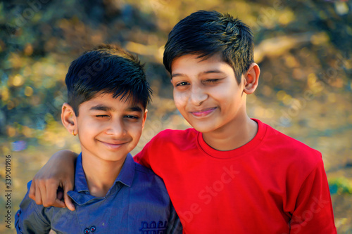two young indian child wink his eye Canvas Print