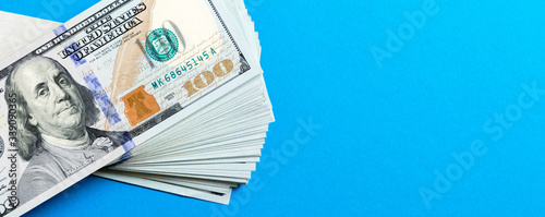 Stack of 100 dollar banknotes on colorful background Wallpaper Mural