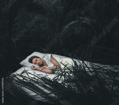 Sleeping woman in deep  forest lies on airbed, digital edited image Wallpaper Mural