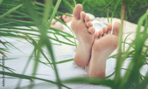 Fototapeta Sleeping woman in deep jungle forest lies on airbed