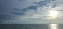 Scenic View Of Lake Erie Against Cloudy Sky During Sunset