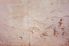 Old Concrete Wall Covered With Pastel Pale Paint.
