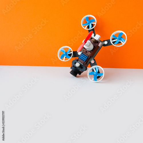 Cuadros en Lienzo Drone multicopter with camera, orange white background