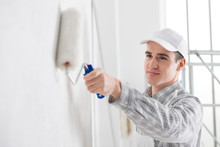 Friendly Young Male Painter Pa...