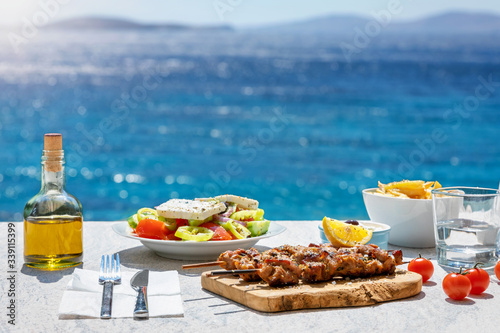 Carta da parati Greek food concept with farmers salad and souvlaki skewers in front of the spark