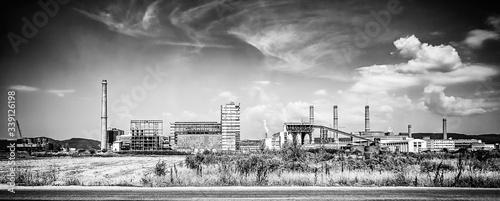 Foto Industrial Buildings Against Sky