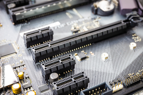 closeup of Pci expess port slot on modern black motherboard. Select focus