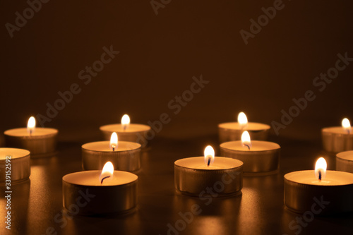 Candles burning in the darkness, devotional and religious image Tablou Canvas