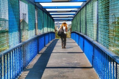 Rear View Of Woman Walking On Footbridge Wallpaper Mural