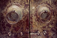 Close-up Of Metallic Door Knockers