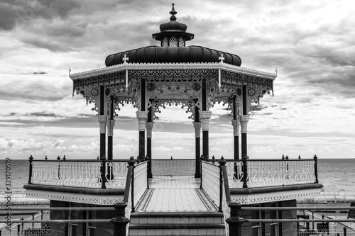 Bandstand Over Sea Against Cloudy Sky Wallpaper Mural