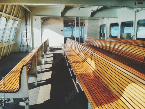 Ship Interior With Wooden Benches Fotobehang