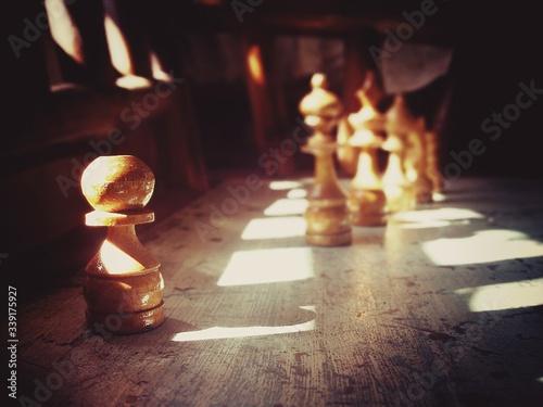 Fototapeta Sunlight Falling On Wooden Chess Pieces