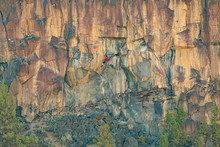 Climber On Overhanging Cliff R...