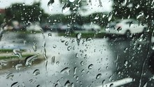 Road Seen Through Wet Glass Window On Rainy Day