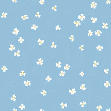 Vector Beautiful Ditsy Floral Seamless Texture. Repeating Pattern Of Small White Flowers On Blue Background. 50's Style Design For Fabric And Wallpaper.