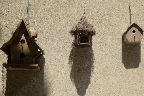 Obraz na plátně Birdhouses Hanging Against Wall
