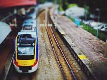 Tilt Shift Image Of Train At Railway Station