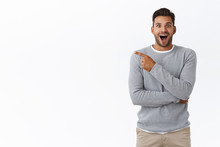 Fascinated, Surprised And Advertisement Concept. Attractive Surprised And Wondered Smiling, Excited Bearded Guy With Happy Attitude, Pointing Left And Stare Impressed Camera With Awe And Excitement