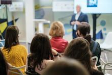 Business Forum Visitors Register At The Front Desk