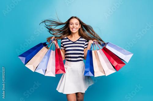 Photo of charming lady traveler walk enjoy shopping center carry many packs hair Fototapete