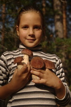 Little Girl In The Forest With...