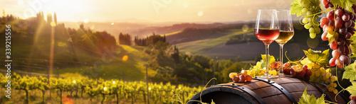 Fototapeta Glass Of Wine With Grapes And Barrel On A Sunny Background. Italy Tuscany Region obraz