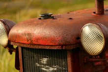 Close-up Of Rusty Tractor In Farm
