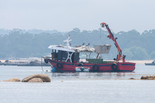 Fishing Trawler Anchored Near The Coast