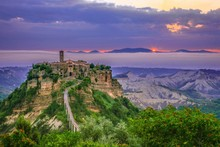 High Angle View Of Civita Di Bagnoregio Amidst Mountains During Sunset