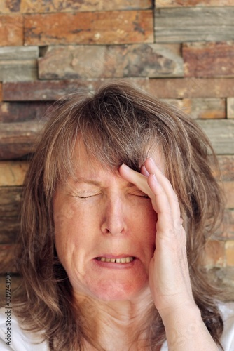 Photo woman with expression showing headache, pain, anguish