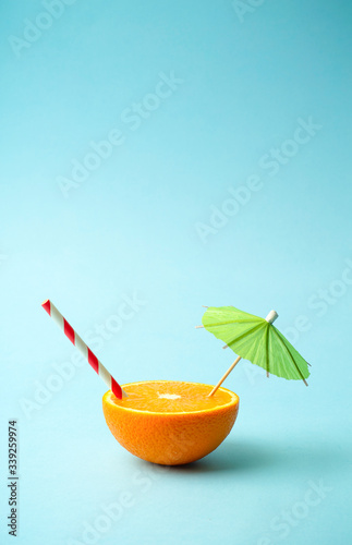 Food summer minimal concept. Orange juice and juicy tropical fruits on a light colored background - 339259974