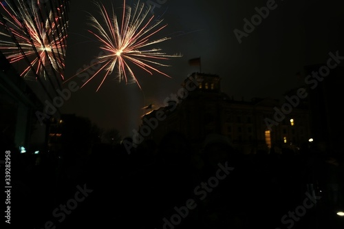 Low Angle View Of Fireworks And Silhouette Buildings At Night #339282958