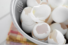High Angle View Of Broken Eggshell In Colander