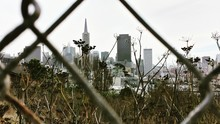 Transamerica Pyramid And Modern Buildings Seen Through Chainlink Fence