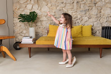 Cute Smiling Toddler Girl Wearing Mother's Shoes