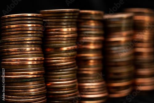 Cuadros en Lienzo Stacks of pennies on a black background.