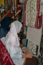 Berber Women Crafting Carpets With Wooden Loom In Tunisia