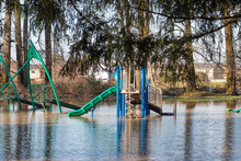 A Flooded Public Park With A Playground