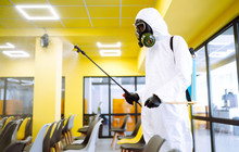 Man Wearing Protective Suit Di...