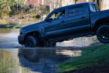 Backing A Black Pickup Truck Out Of A Flood