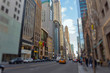 Street view of light traffic in a New York City street. Shot with manual Tilt Shift lens for selective focus effect.