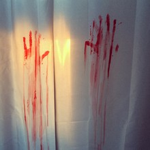 Close-up Of Bloody Handmarks On Curtain