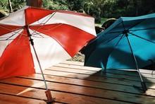Open Umbrellas On Pier